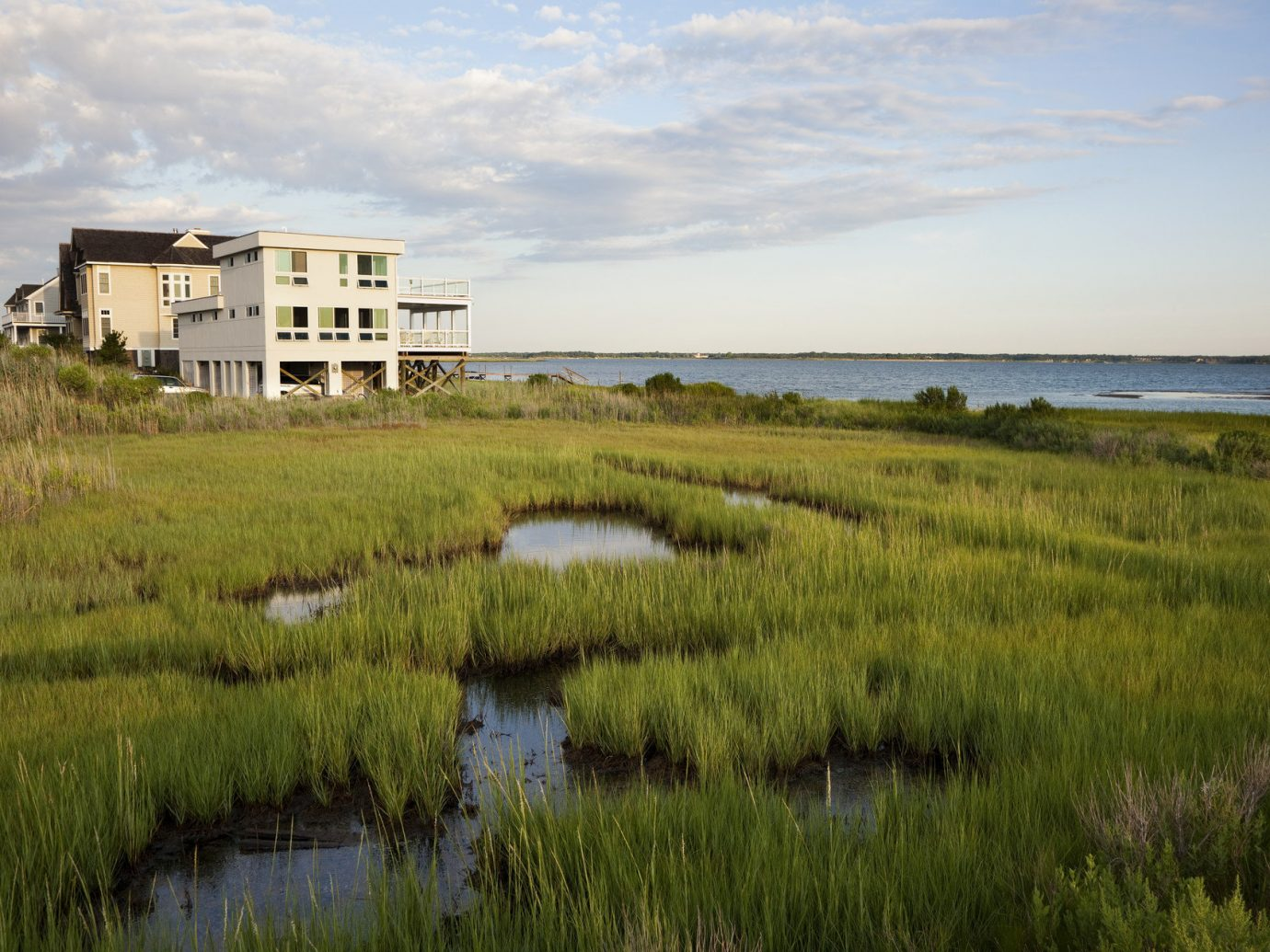 Beach East Coast USA Trip Ideas grass sky outdoor habitat field geographical feature marsh natural environment wetland shore grassland ecosystem Nature plain prairie salt marsh grassy Coast green rural area meadow landscape reflection Sea waterway polder bog lush pasture land