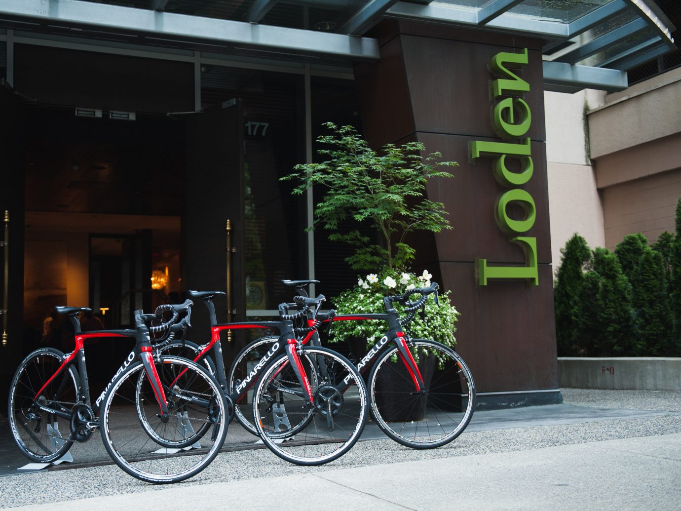 Hotels bicycle outdoor building sidewalk parked vehicle transport lane urban area road City leaning street cycling sports equipment curb