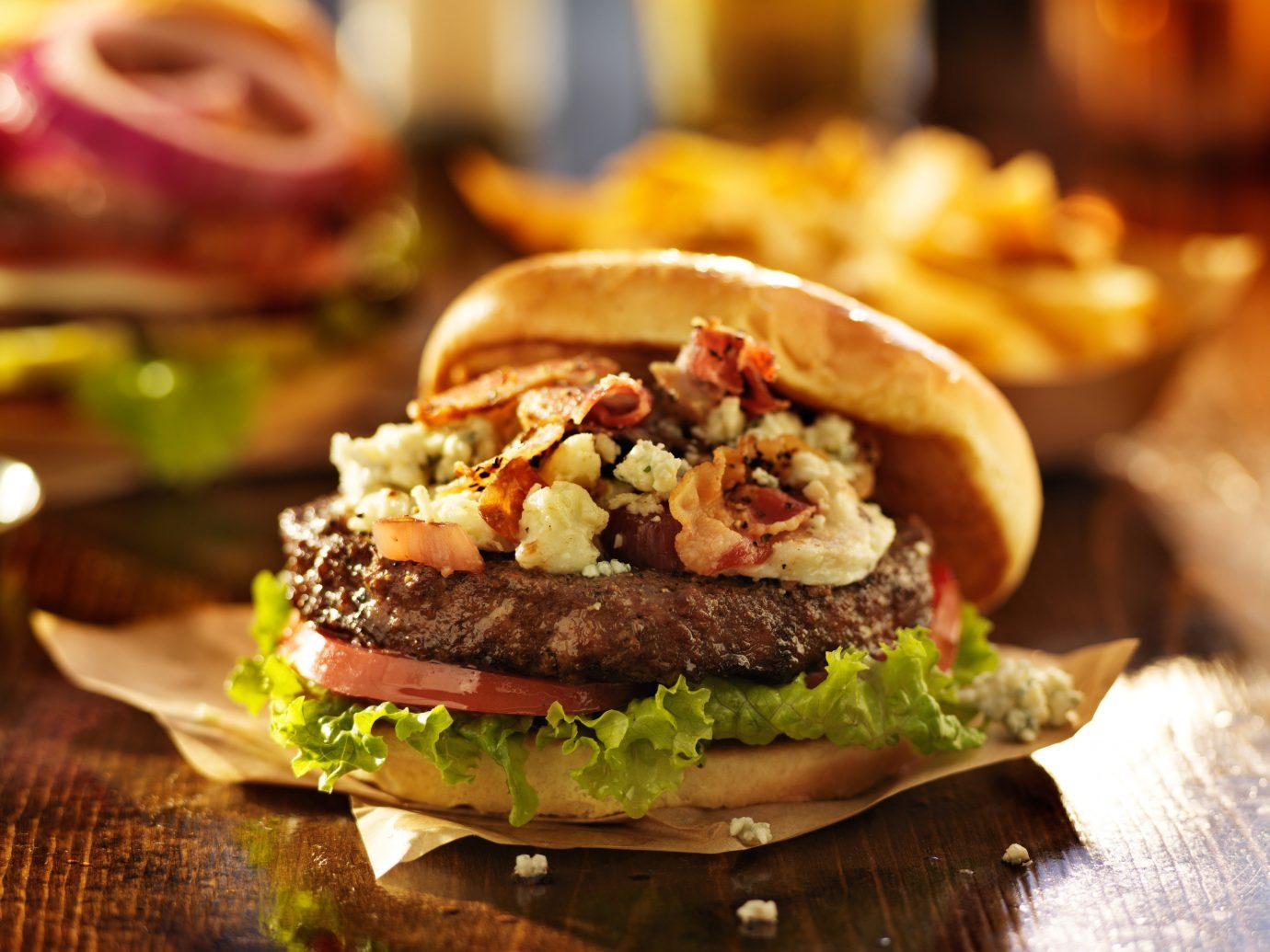 Food + Drink food indoor dish hamburger veggie burger meat sandwich snack food slider produce meal cheeseburger sloppy joe cuisine fast food restaurant
