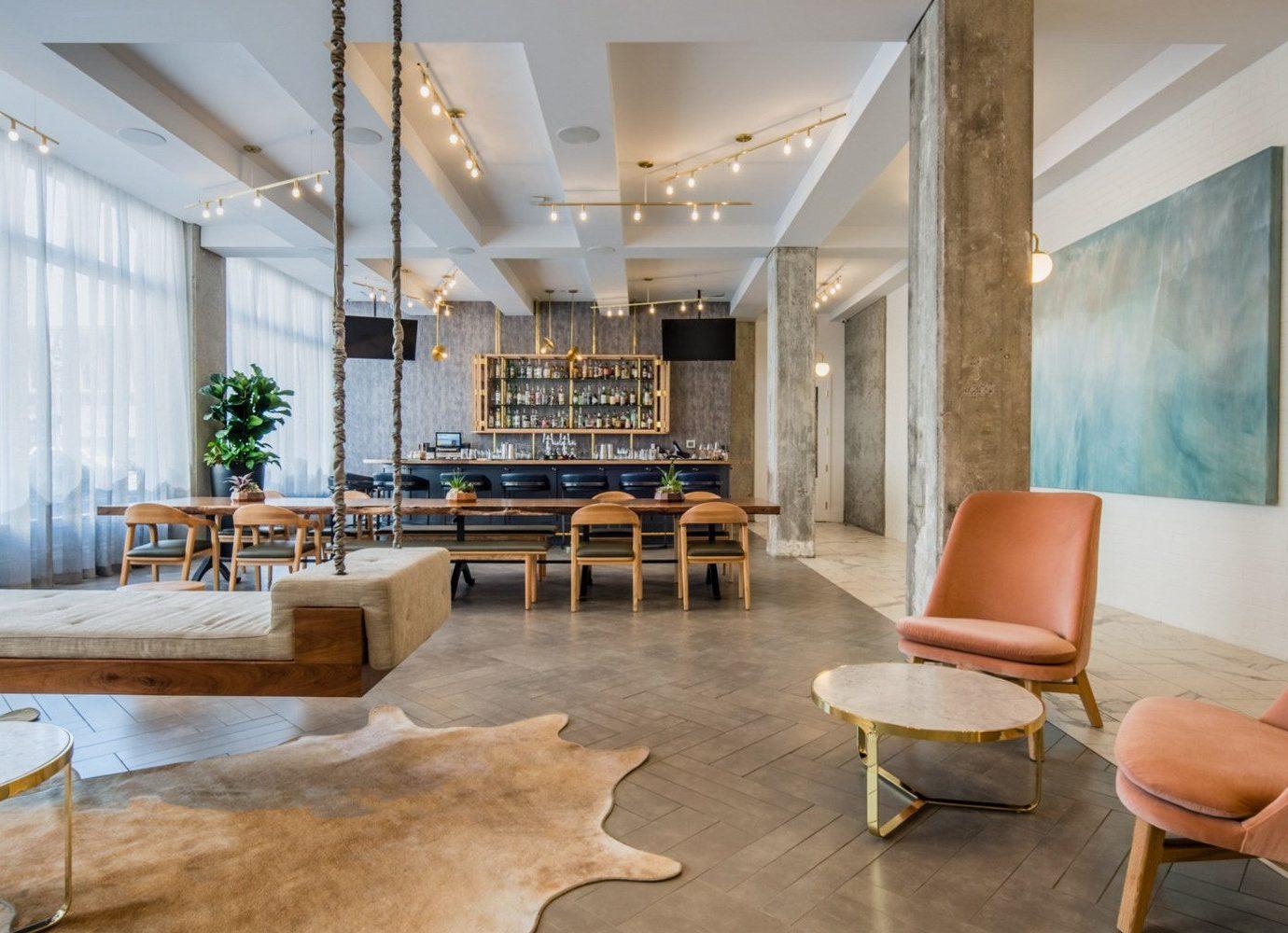 Boutique Hotels Hotels Luxury Travel indoor floor room Living interior design Lobby living room ceiling furniture loft table interior designer flooring area