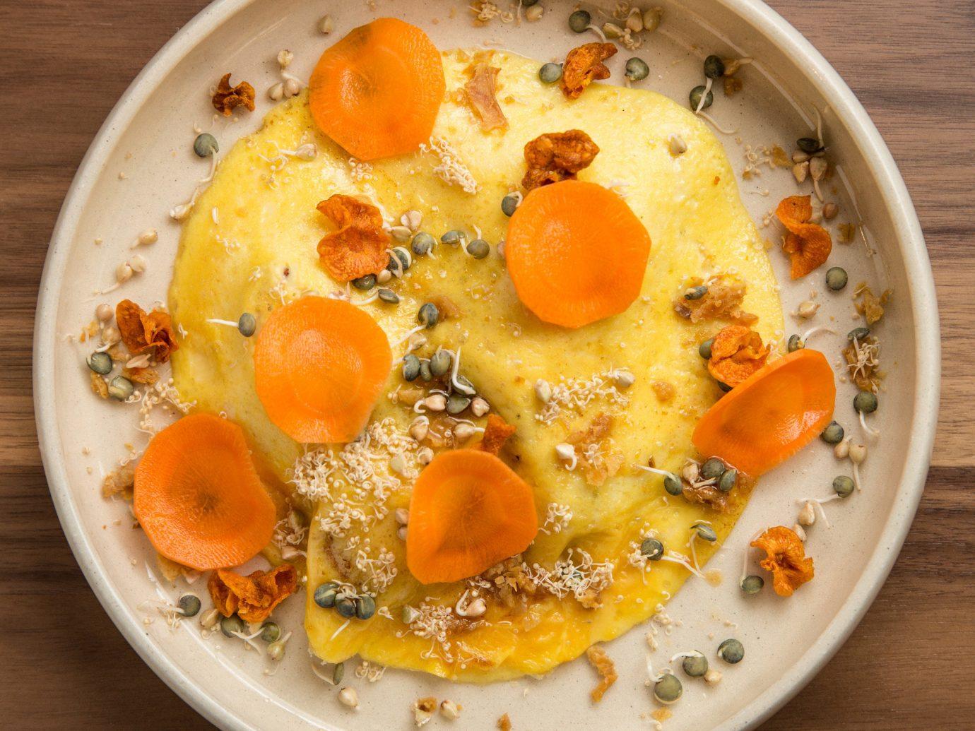 Food + Drink table food dish plate plant produce wooden meal land plant vegetable breakfast flowering plant orange eaten