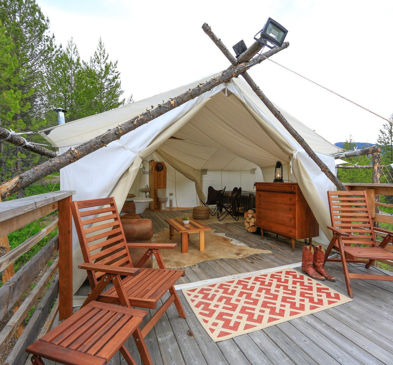 Family Travel National Parks Trip Ideas sky tree wooden chair property cottage hut Resort outdoor structure log cabin Villa roof