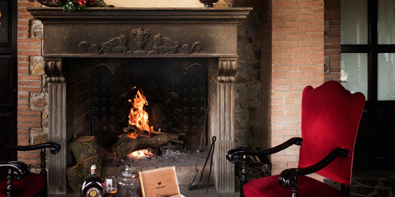 Fireplace chair hearth lighting home living room