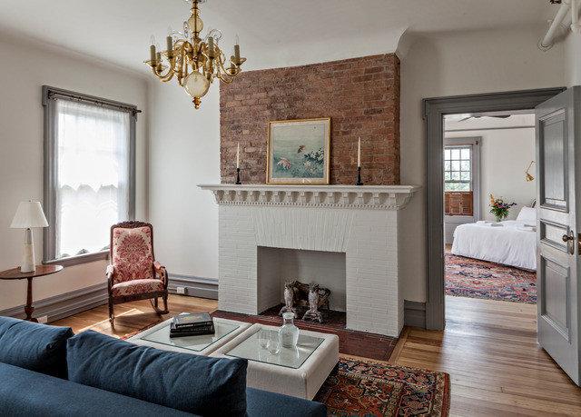 sofa living room hearth home Fireplace interior designer house flooring hardwood leather