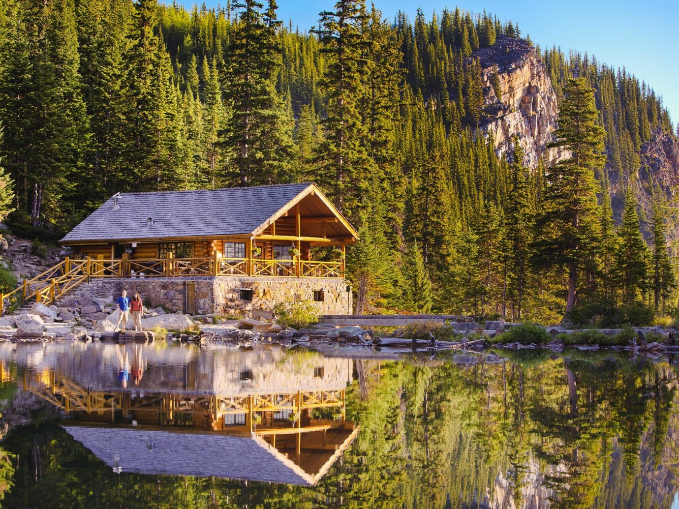 Alberta Canada Road Trips tree outdoor reflection Nature pond water wilderness Lake home cottage plant wood real estate mountain Forest national park landscape tourist attraction estate mount scenery sky hut reservoir house log cabin wooded area surrounded