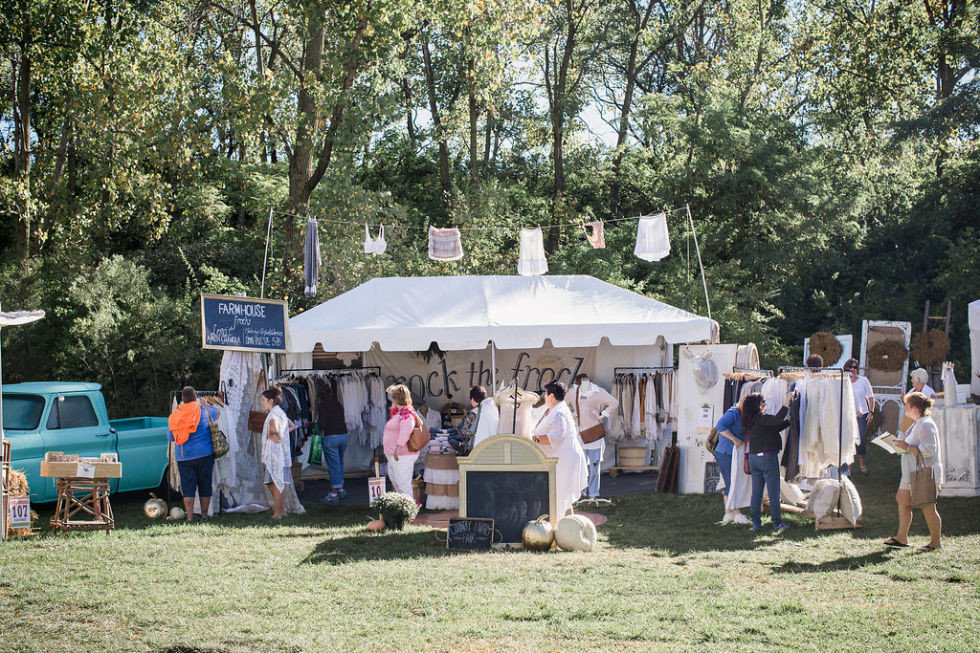 Arts + Culture tree outdoor grass City group people community fair Picnic market several