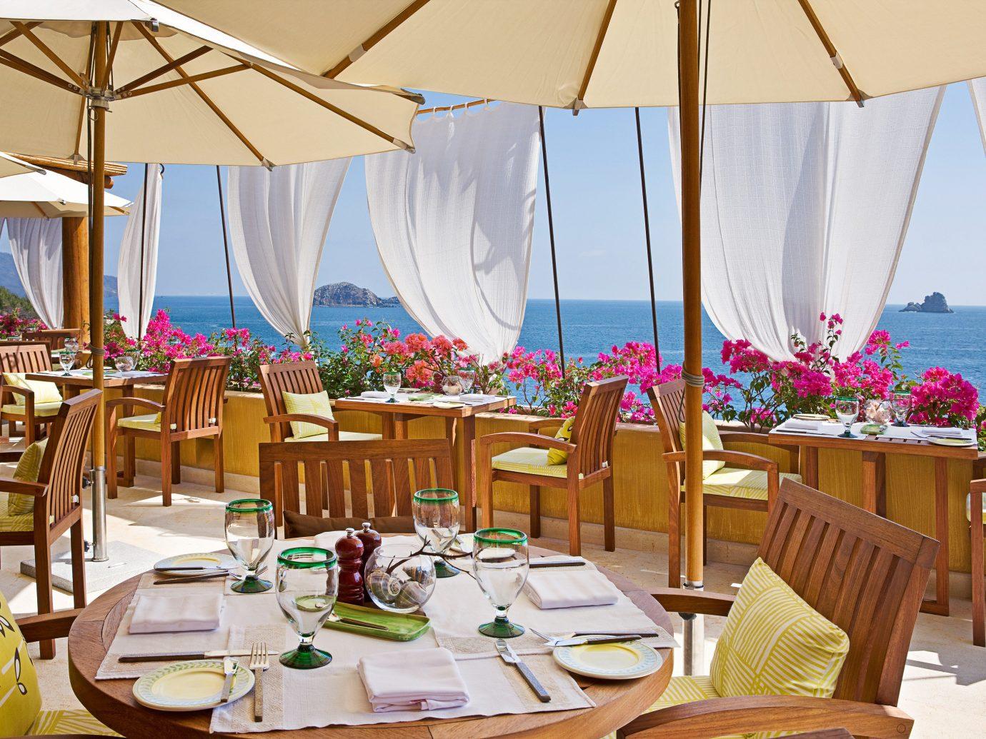 Beach Beachfront Dining Honeymoon Hotels Island Luxury Mexico Romance Romantic Rooftop Tulum table chair meal restaurant wedding Resort function hall set decorated furniture