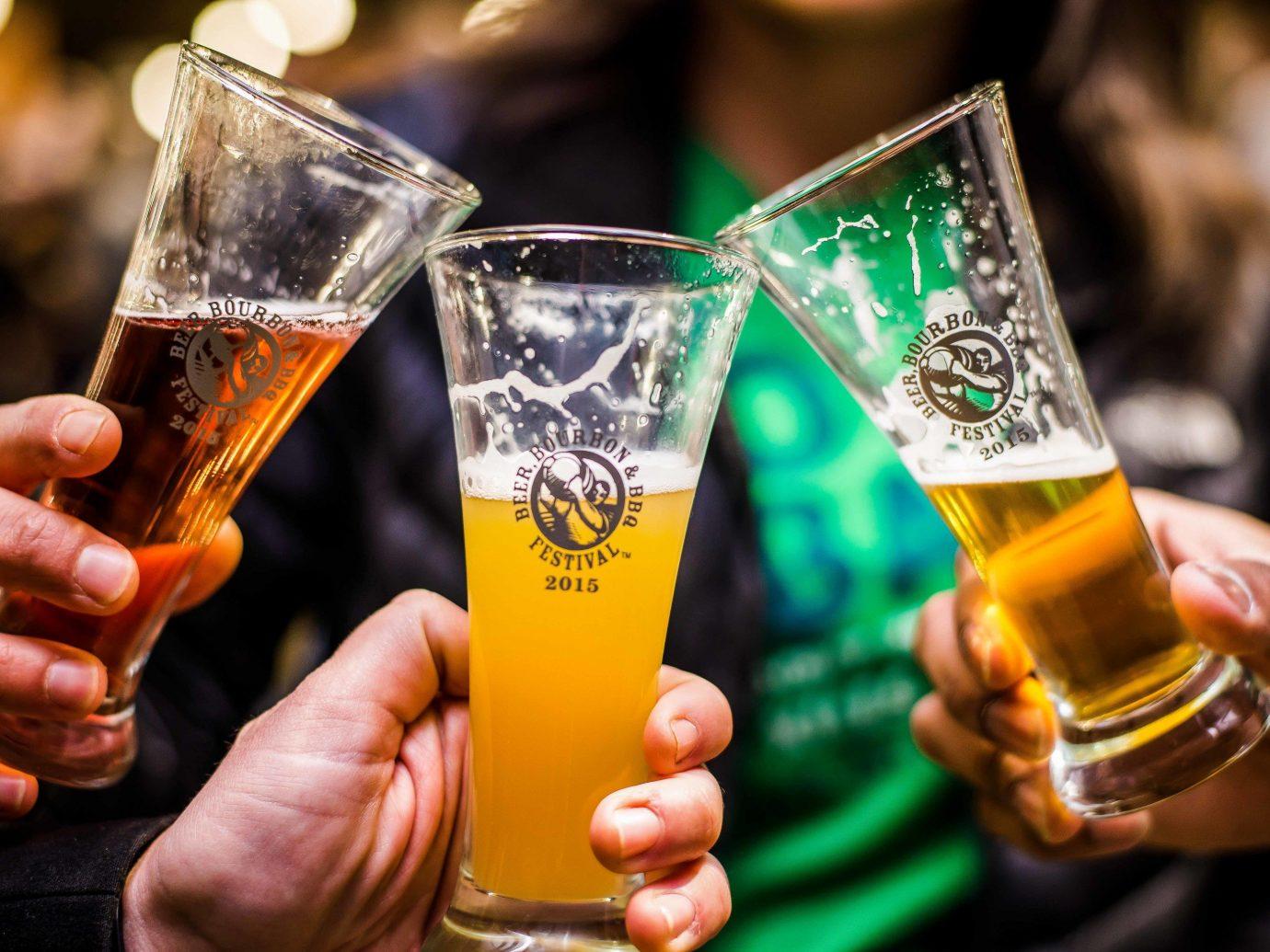 Offbeat person Drink alcoholic beverage beer alcohol liqueur distilled beverage hand beer cocktail pint us beer glass glass beverage orange