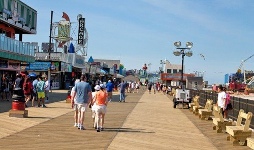 Beach sky outdoor ground boardwalk walkway Town plaza pedestrian people pier infrastructure port dock town square