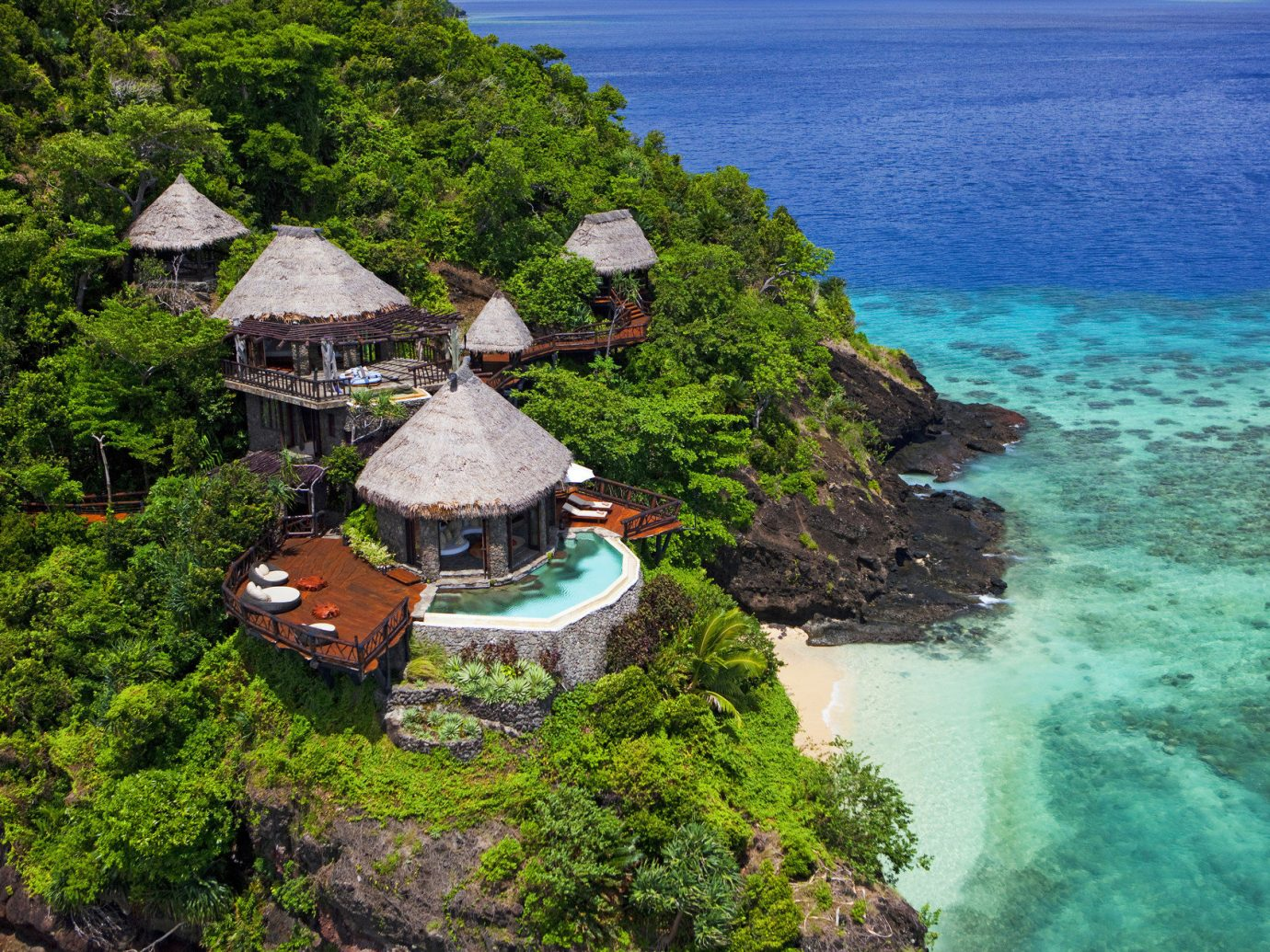 All-Inclusive Resorts Beach Boutique Hotels clear water Greenery Hotels huts isolation Luxury Luxury Travel Ocean private private pool quaint remote Romance serene Tropical turquoise white sands outdoor water Nature vacation mountain Coast Sea tropics terrain surrounded hillside lush