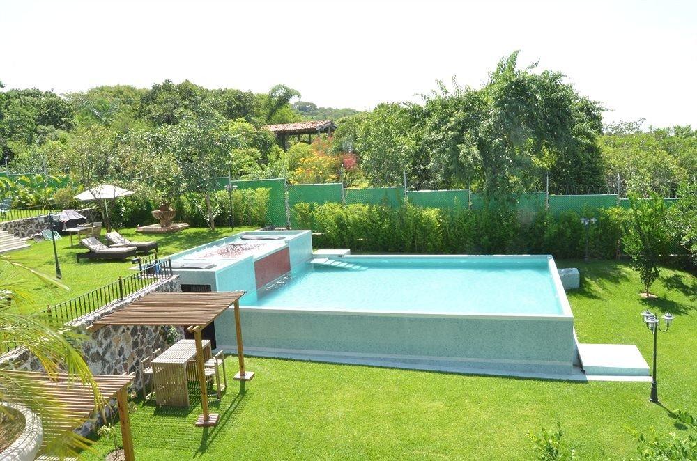 grass tree swimming pool property backyard lawn landscape architect Villa outdoor structure yard Garden lush