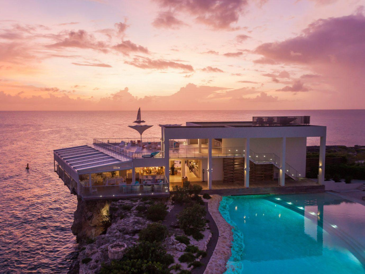 Hotels Trip Ideas sky outdoor water Sunset Sea Ocean vacation dusk Resort evening bay Coast estate clouds day