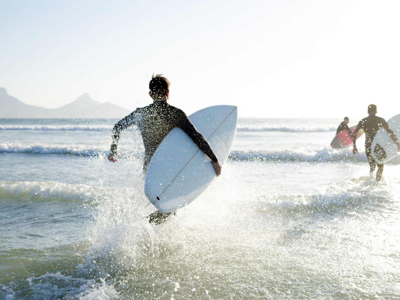 Influencers + Tastemakers Offbeat Style + Design Travel Shop Trip Ideas water outdoor sky surfing man water sport person surfboard Ocean sports Sport surface water sports wind wave boardsport surfing equipment and supplies wave Sea sailing extreme sport windsurfing paddle day