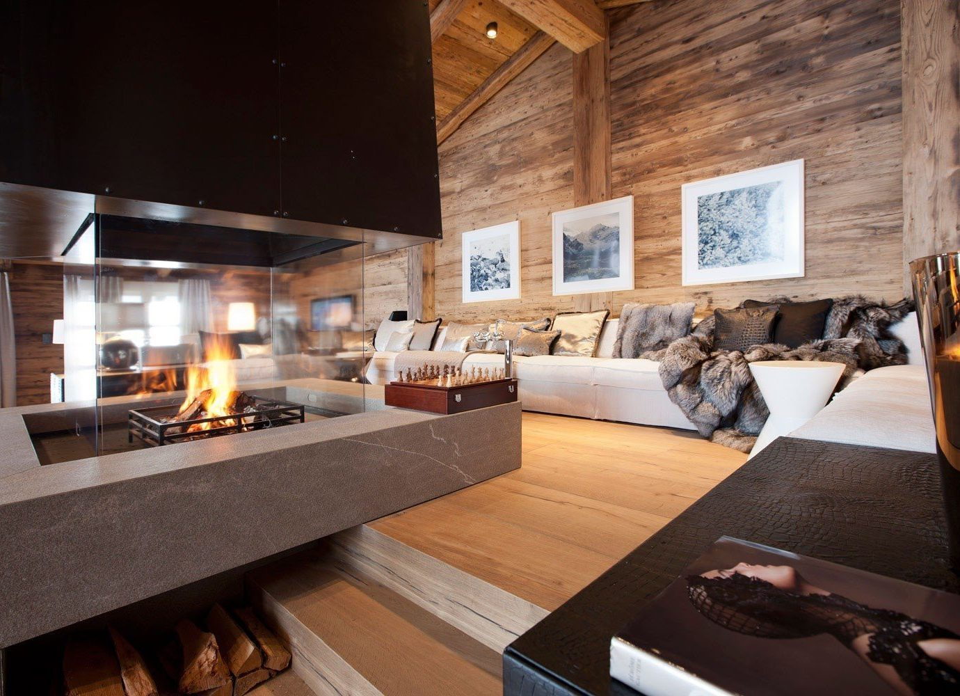 Hotels Luxury Travel Mountains + Skiing Trip Ideas indoor table Living floor room property home estate living room interior design hardwood wood Design hearth wood flooring furniture Modern