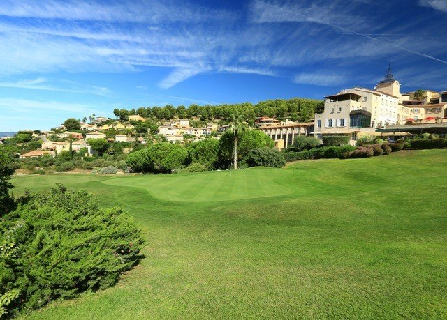 grass sky structure property field green sport venue grassland golf course grassy golf club lawn hill residential area meadow lush mansion Golf panorama hillside