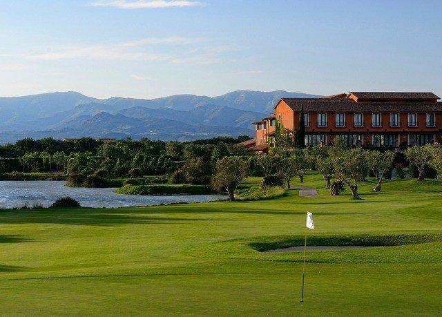 grass sky mountain structure sport venue sports golf course golf club Golf outdoor recreation green recreation Lake lush
