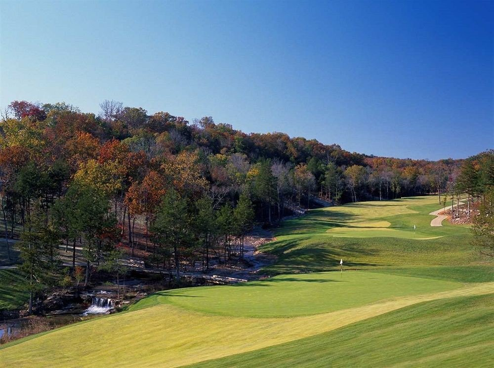 Golf Nature Outdoor Activities Outdoors grass sky tree structure field sport venue golf course grassland golf club outdoor recreation sports grassy recreation meadow lush day