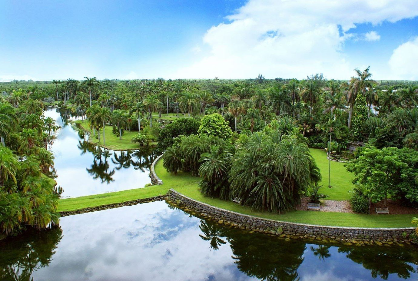 Offbeat tree sky water outdoor River Nature Boat structure pond reflection sport venue Lake estate golf course Garden botanical garden wetland Resort agriculture aerial photography Jungle park surrounded land