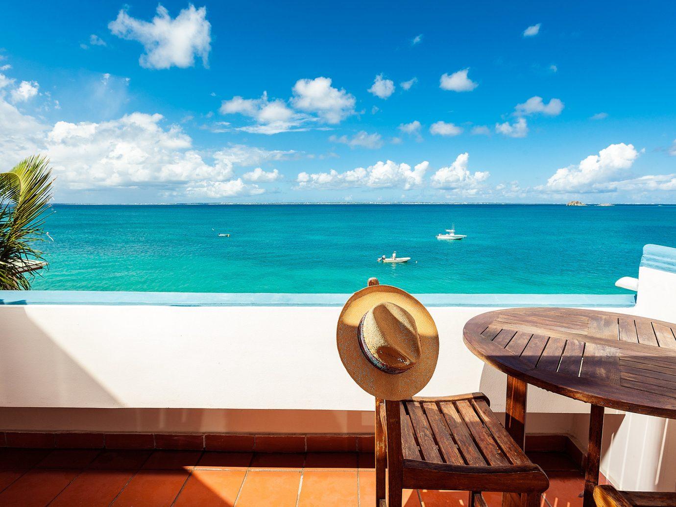 Hotels sky water Sea body of water Ocean vacation caribbean shore Resort coastal and oceanic landforms cloud Beach tropics horizon leisure swimming pool Island