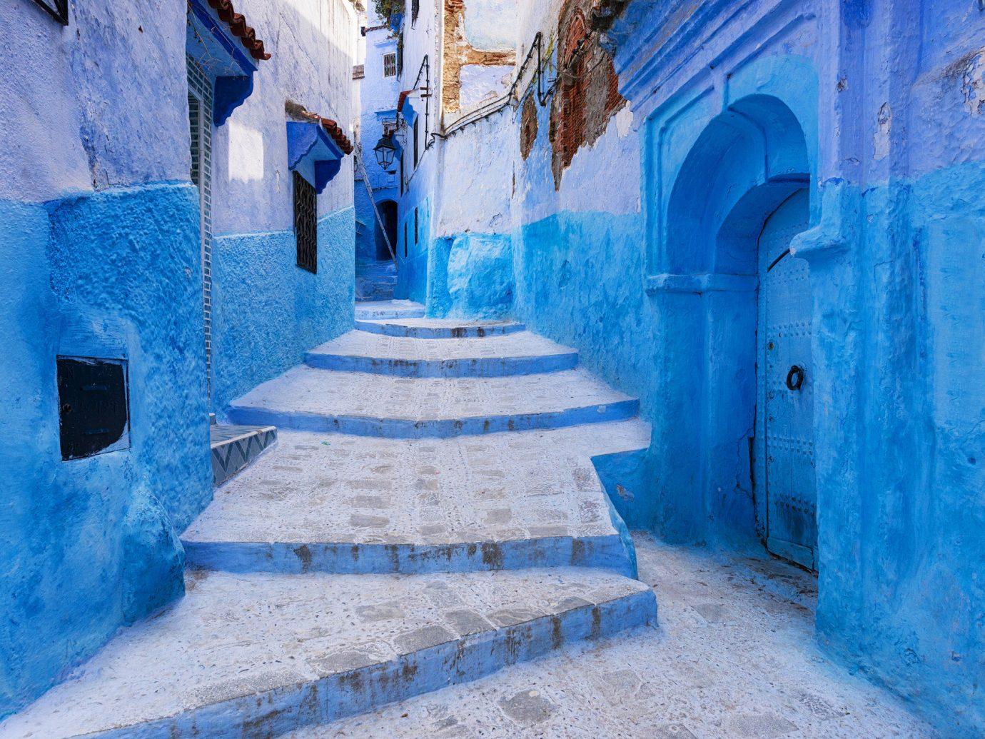 Arts + Culture Marrakech Morocco Style + Design Trip Ideas building color blue Winter wall urban area freezing season snow ice concrete cement dirty