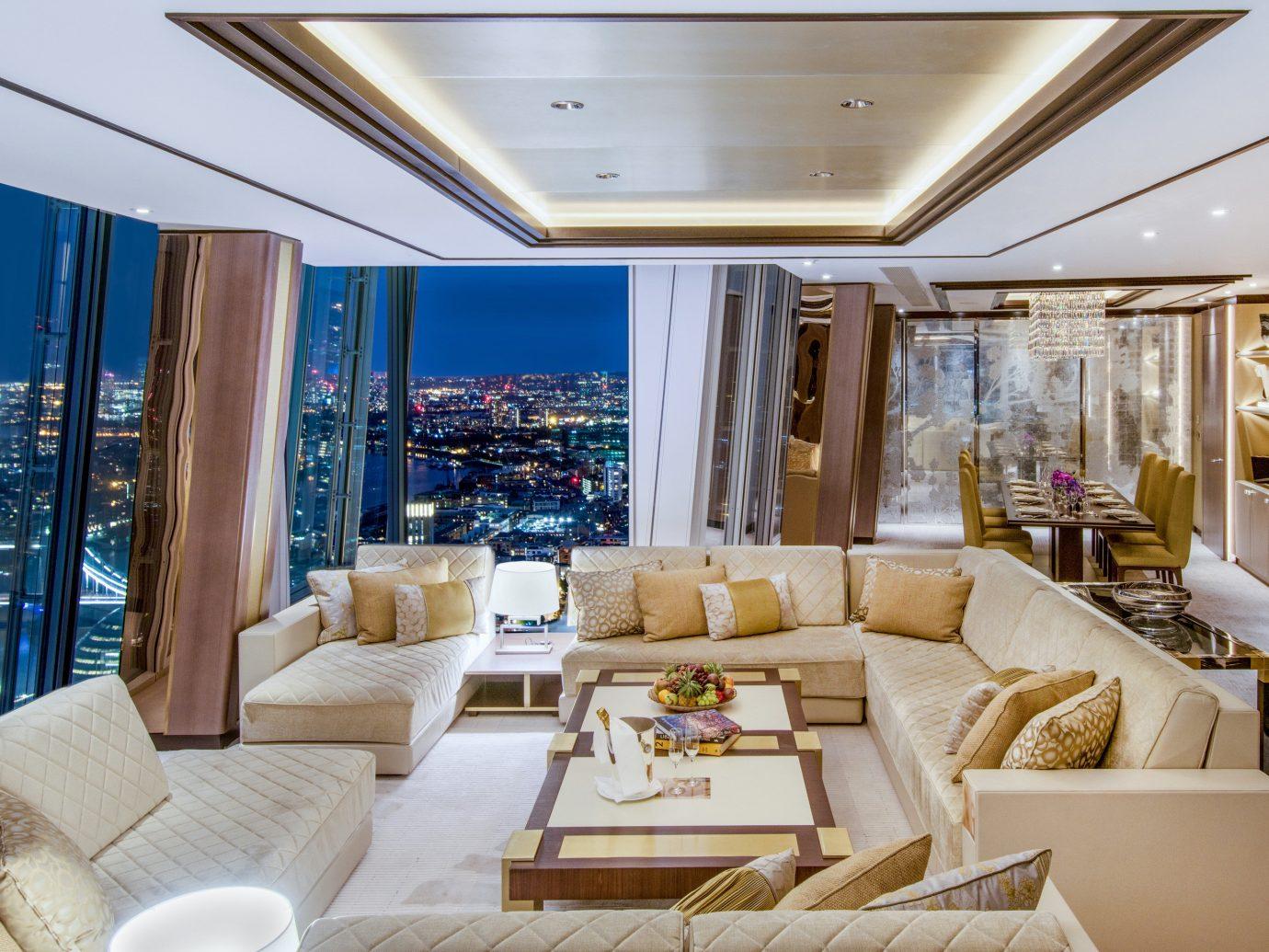 Hotels Luxury Travel indoor sofa Living room living room interior design ceiling furniture white penthouse apartment real estate apartment Suite interior designer condominium window