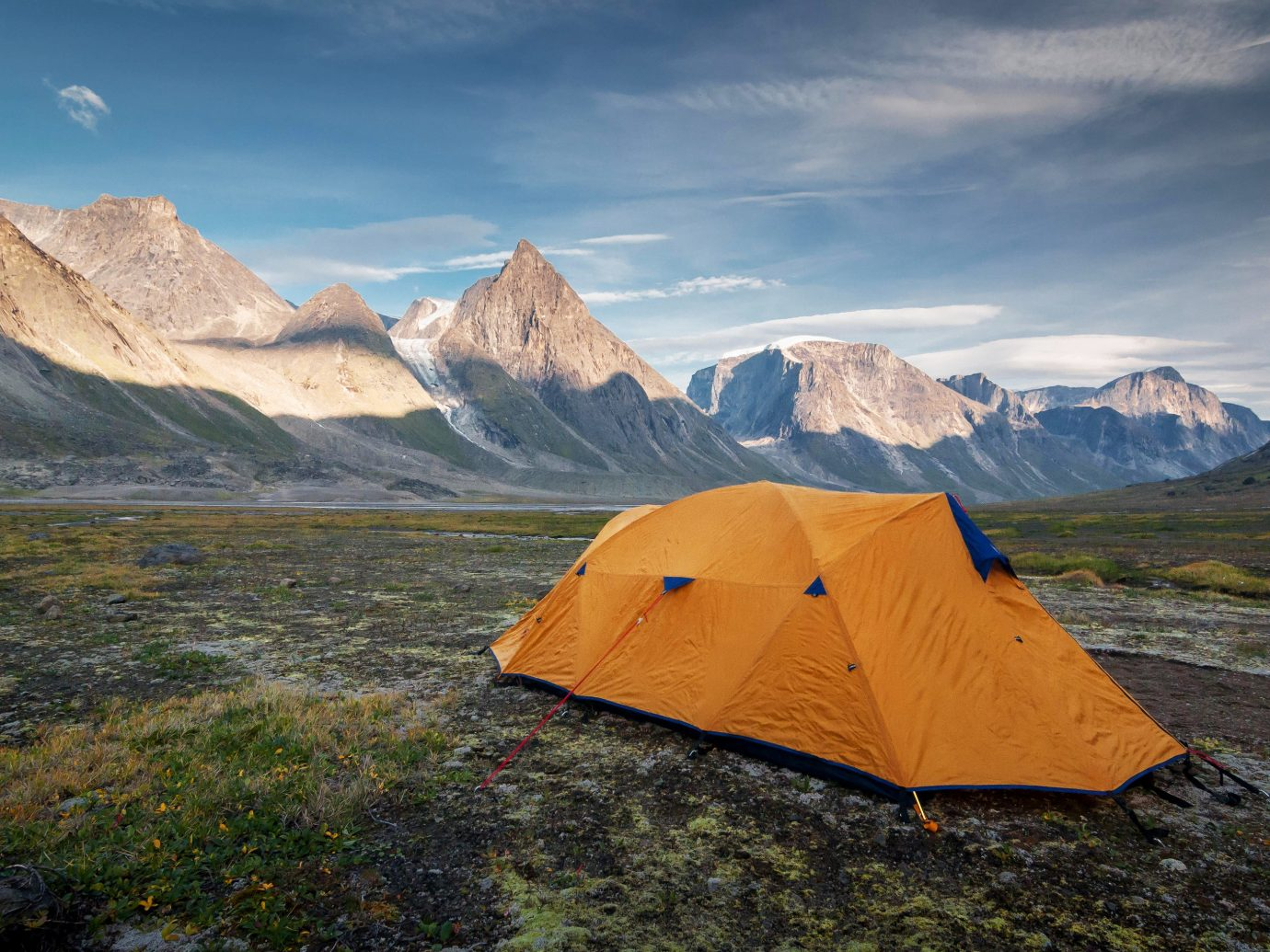 National Parks Outdoors + Adventure Travel Tips Trip Ideas mountain sky outdoor outdoor object tent Nature wilderness mountainous landforms ecosystem fell mountain range highland national park tundra morning terrain landscape hill ecoregion cloud Adventure rock mount scenery valley ridge glacial landform elevation grassland plateau summit Lake accessory