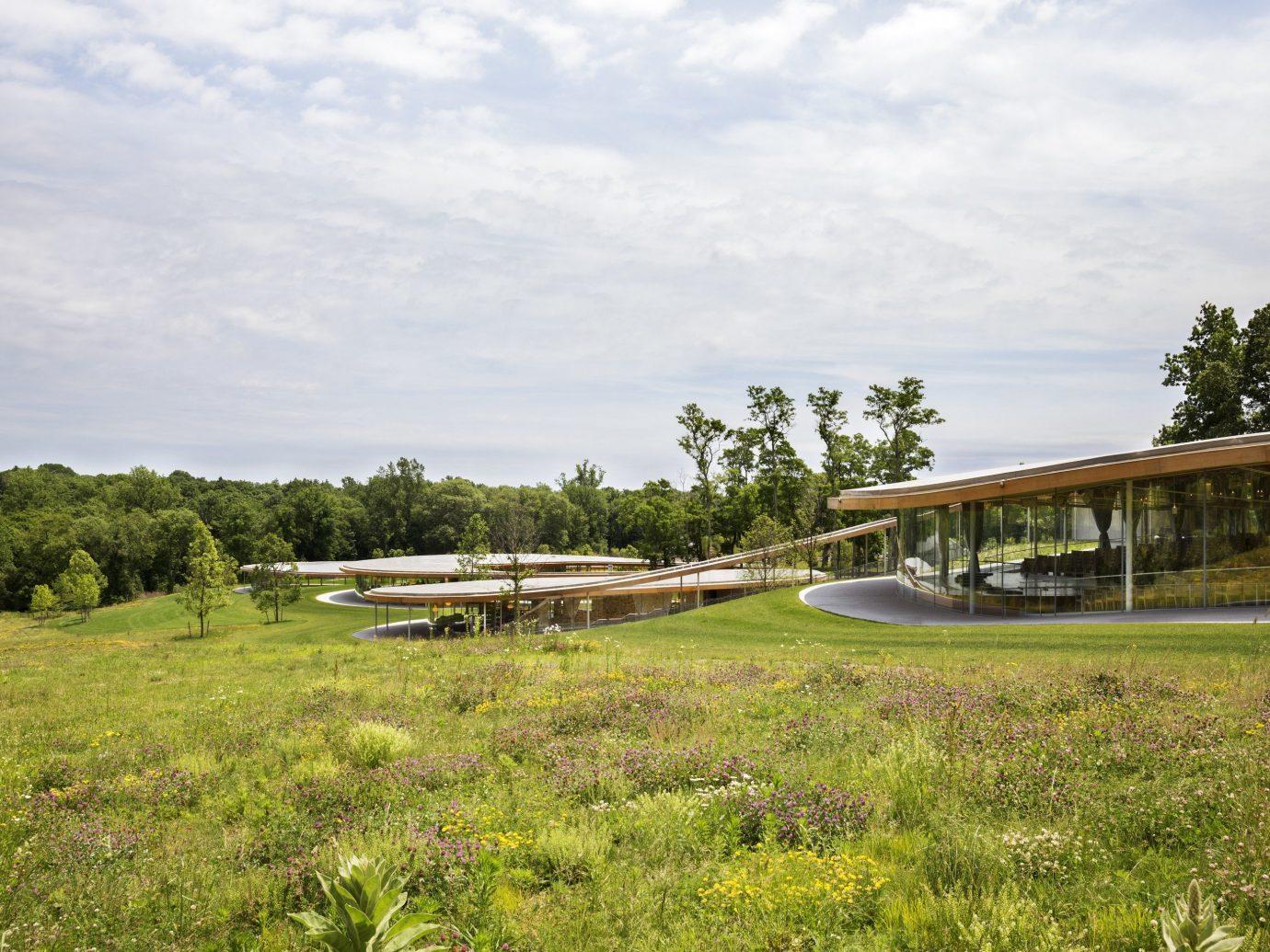 Hotels Trip Ideas grass outdoor sky tree field grassy rural area estate landscape green lush day