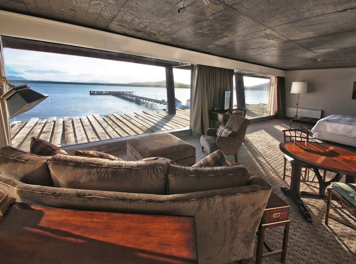 Beachfront Bedroom Deck Hotels Luxury Patio Scenic views Suite Waterfront floor indoor ceiling room property vehicle Boat passenger ship yacht estate home interior design cottage real estate living room luxury yacht ship Villa watercraft furniture several