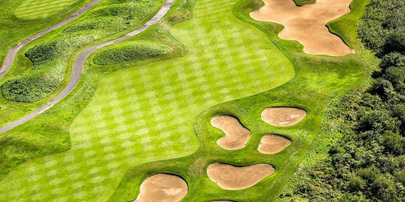 Outdoors + Adventure grass green structure ecosystem botany aerial photography leaf lawn golf club terrain golf course plant fabric