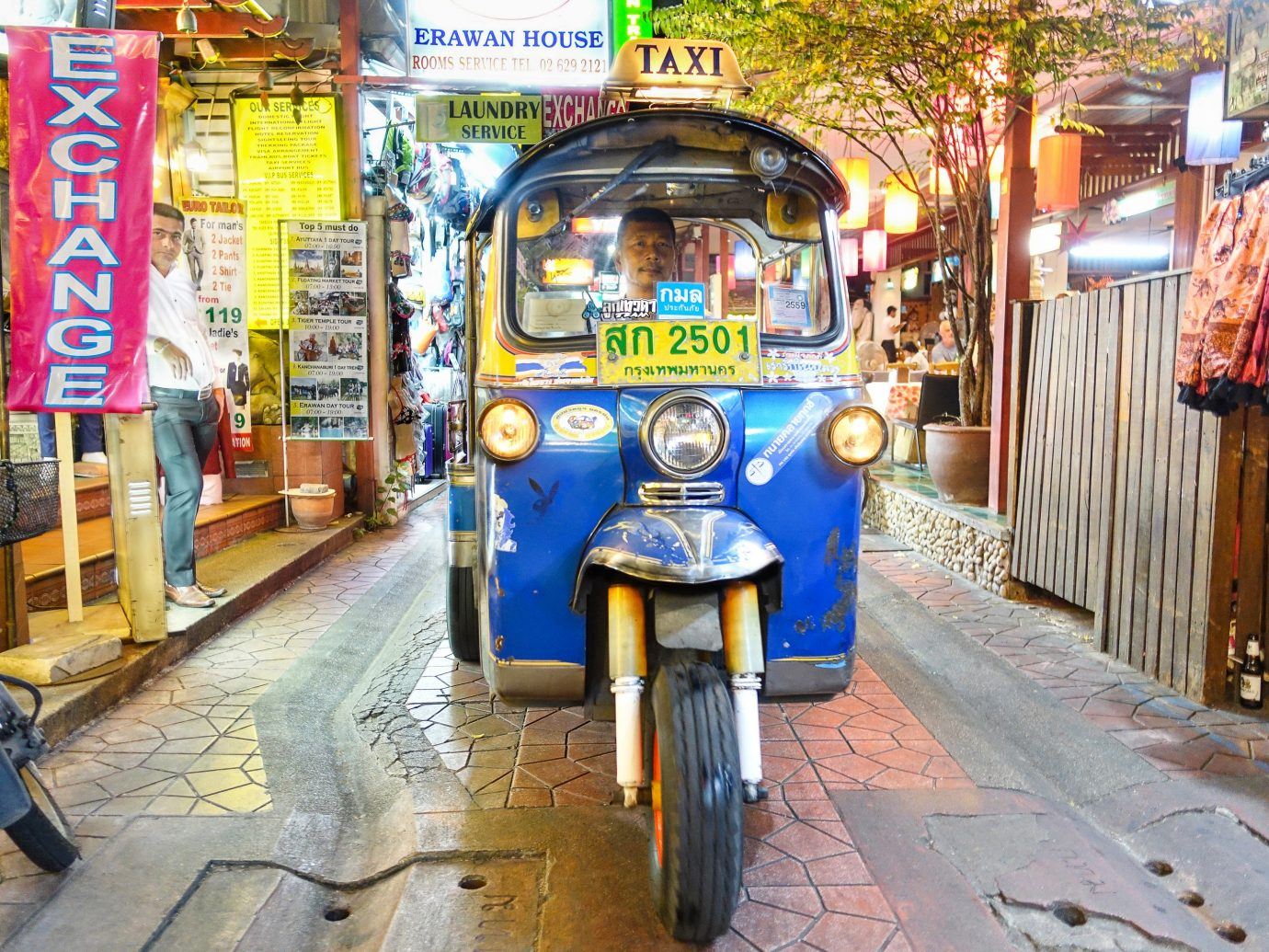 Hotels ground road transport outdoor street City urban area vehicle sidewalk infrastructure rickshaw way public transport travel pedestrian colorful