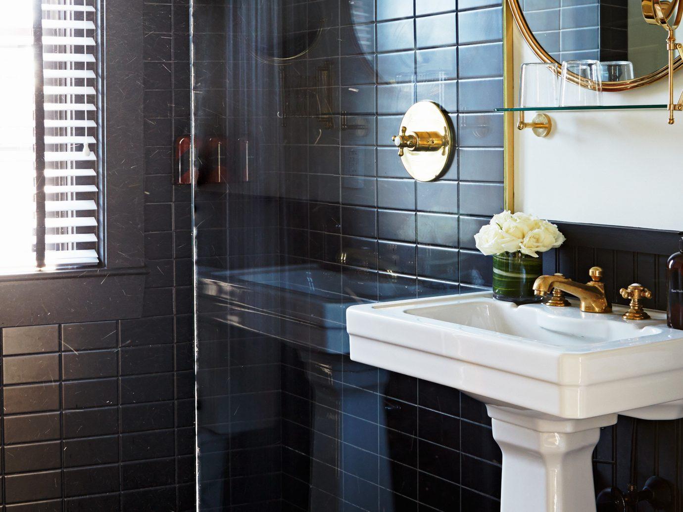 Bath Boutique Budget City Design Hip Modern Weekend Getaways indoor bathroom room property floor home tile interior design plumbing fixture flooring sink countertop estate apartment tiled