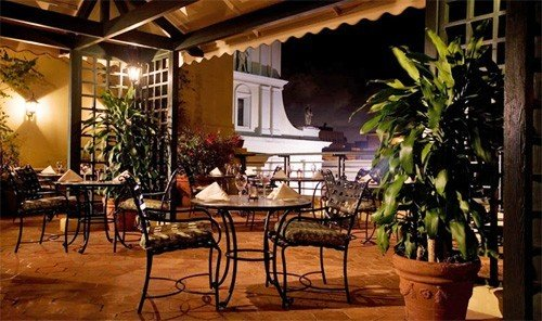 Food + Drink property room restaurant estate porch lighting home Dining dining room hacienda Resort real estate Villa outdoor structure plant cottage Courtyard furniture area dining table