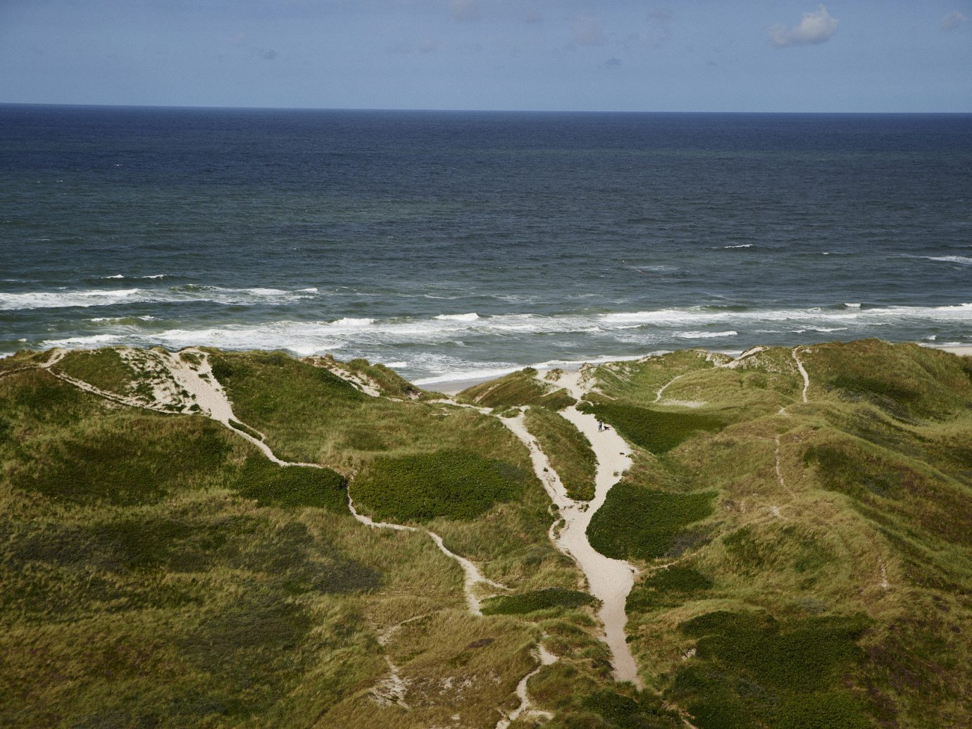 Beach dunes grass Ocean ocean view path sand Travel Tips outdoor water Coast shore Sea body of water Nature cliff horizon wind wave wave terrain cape rock bay wind cove aerial photography