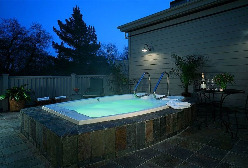 Hot tub/Jacuzzi tree swimming pool property backyard billiard room lighting jacuzzi Villa mansion landscape lighting Hot tub