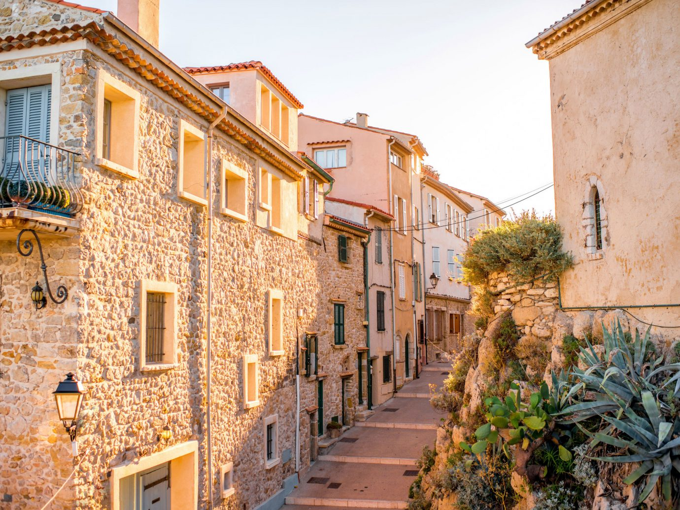 Hotels Travel Tips Trip Ideas building outdoor Town neighbourhood road property street house human settlement wall alley Village residential area brick facade estate infrastructure waterway apartment stone