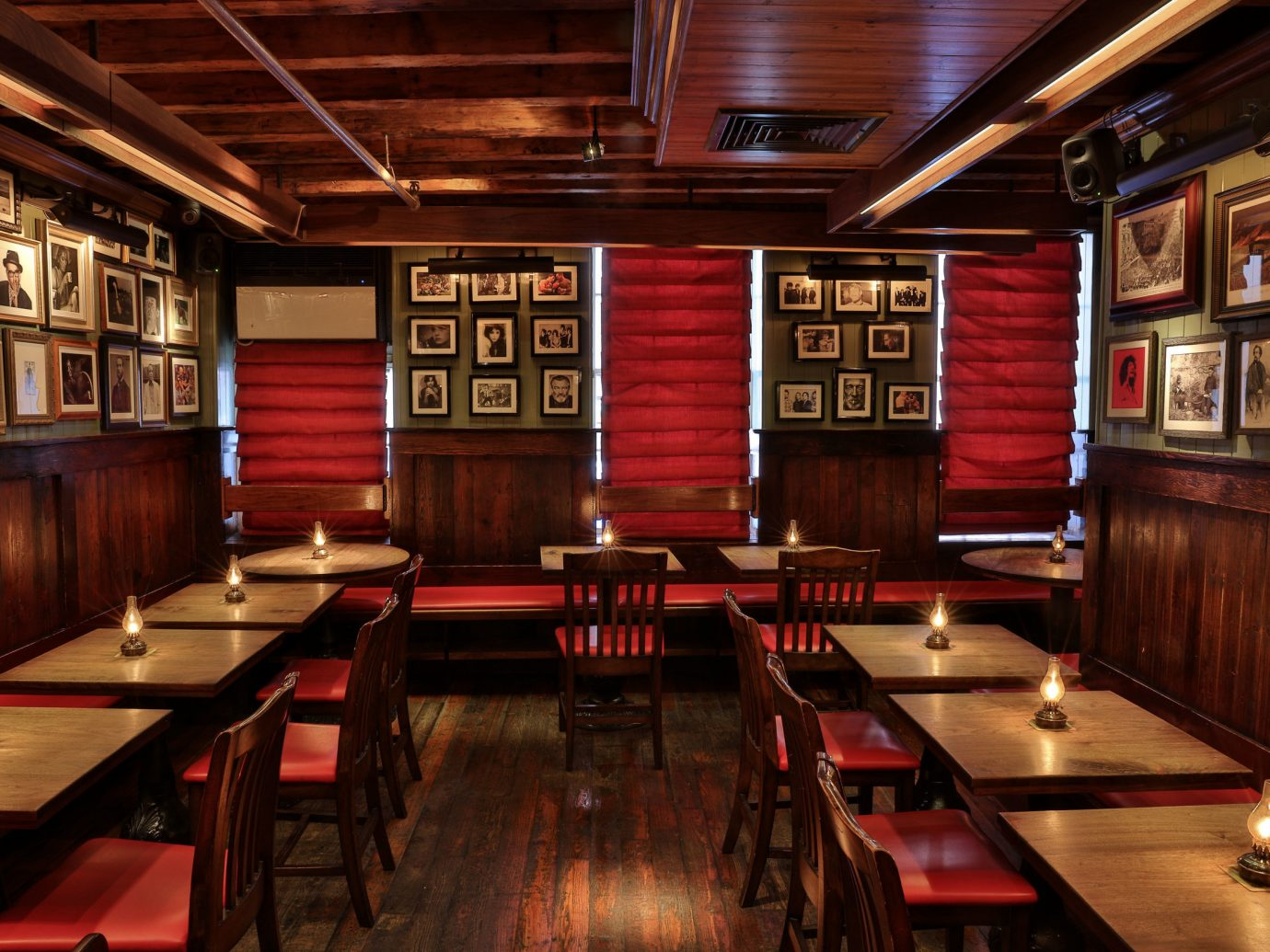 Food + Drink indoor floor table ceiling room interior design restaurant Bar tavern pub café shelf wood furniture dining room