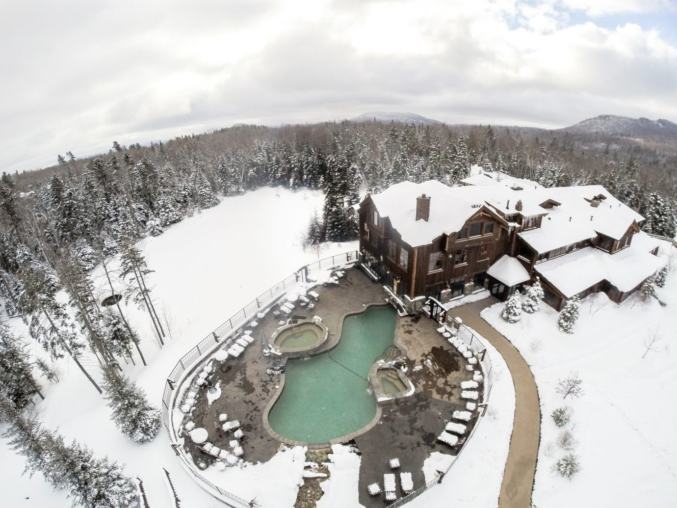 Health + Wellness Spa Retreats Trip Ideas outdoor snow Winter weather geological phenomenon Resort season piste aerial photography winter sport mountain range ski equipment chain
