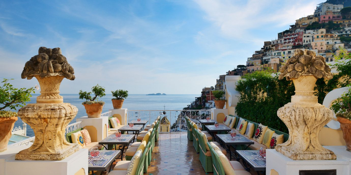 Buildings calm Cliffs Dining Elegant europe Hotels houses landscape Luxury Ocean ocean view outdoor dining overlook Patio regal remote serene sophisticated Terrace view sky outdoor vacation landmark tourism palace ancient history travel temple Resort Beach several