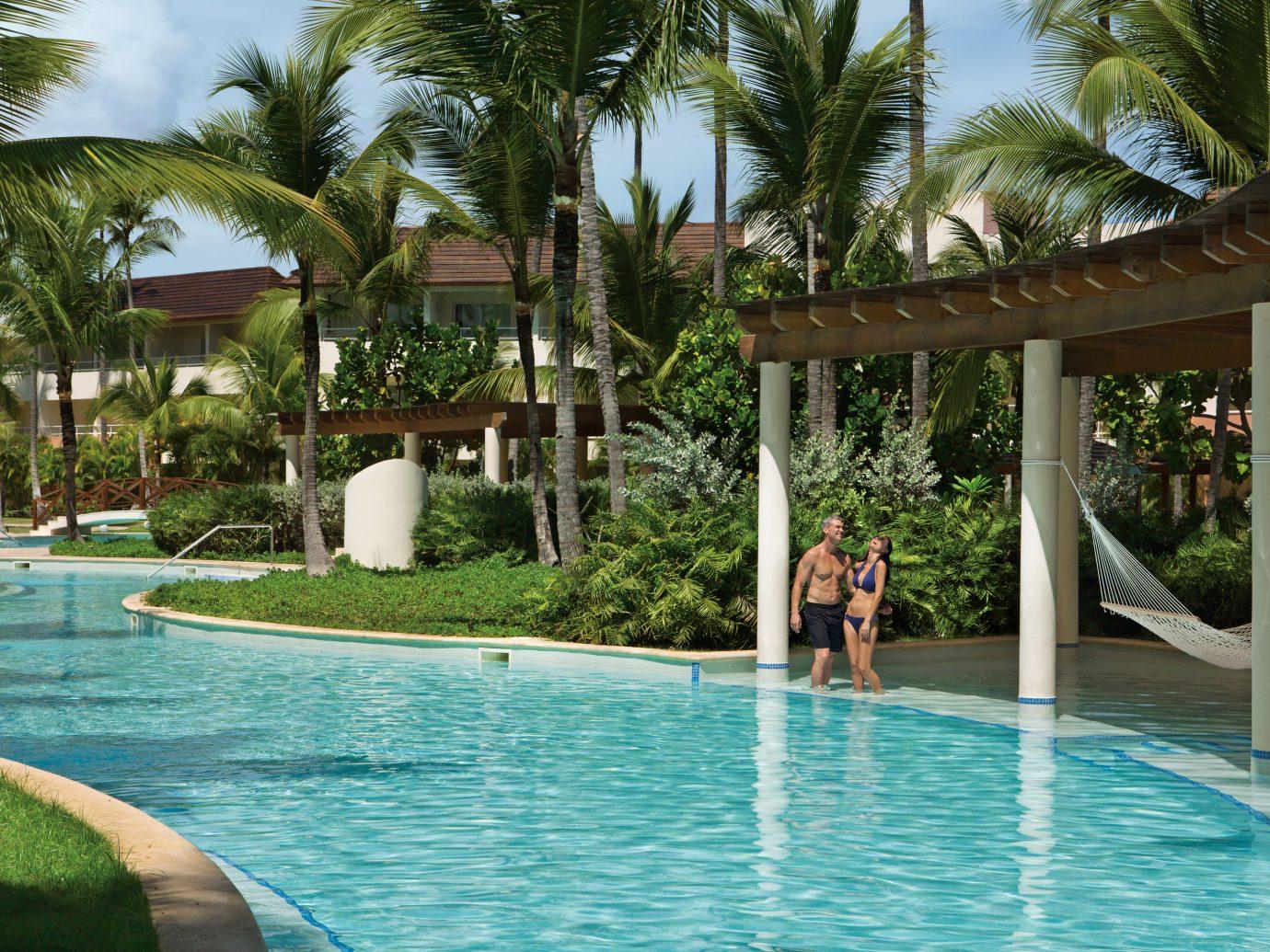 All-Inclusive Resorts Hotels Romance tree outdoor swimming pool Pool leisure Resort property vacation caribbean estate arecales Villa resort town condominium tropics backyard swimming