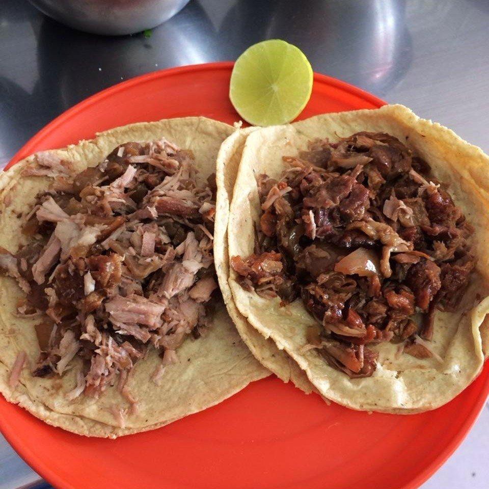 Food + Drink food plate table dish meat carnitas pulled pork cuisine cheesesteak sloppy joe lunch bulgogi beef sandwich snack food meal piece de resistance