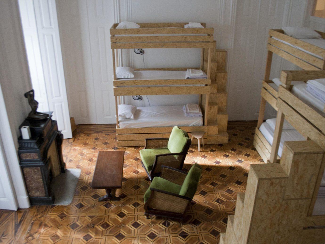 bed Bedroom bunk beds homey Hotels natural light Rustic floor indoor room property furniture home wood living room cottage stairs flooring