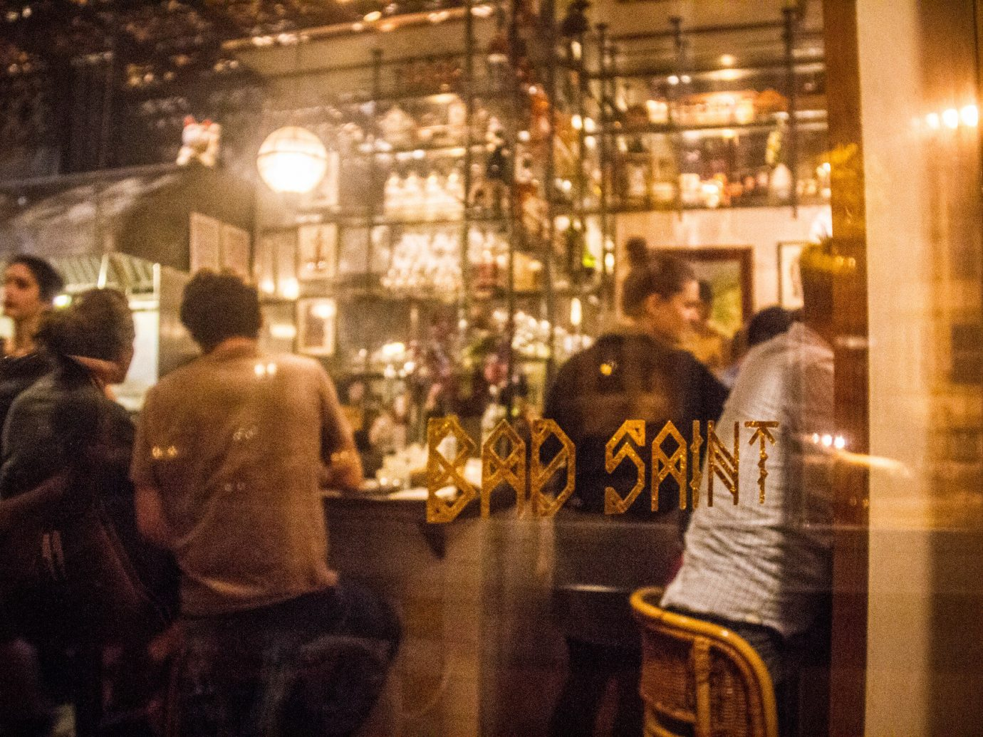Food + Drink person indoor crowd night street Bar restaurant bazaar shopping