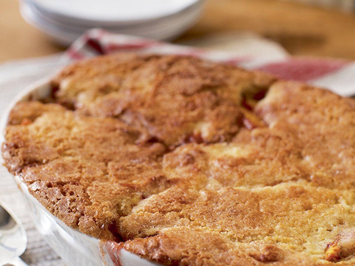 Food + Drink food plate indoor dish dessert piece baked goods breakfast meal produce slice pie fruit baking flavor flowering plant
