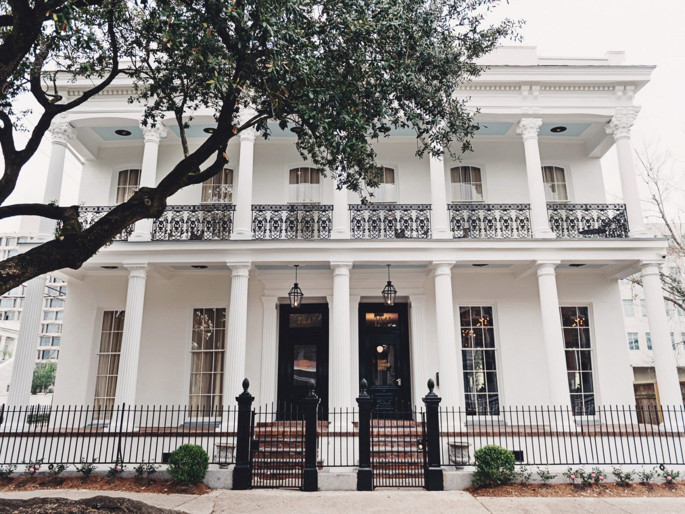 Boutique Hotels Food + Drink Girls Getaways Hotels New Orleans Trip Ideas Weekend Getaways tree property outdoor building neighbourhood house Architecture home estate facade plaza Courtyard mansion condominium palace