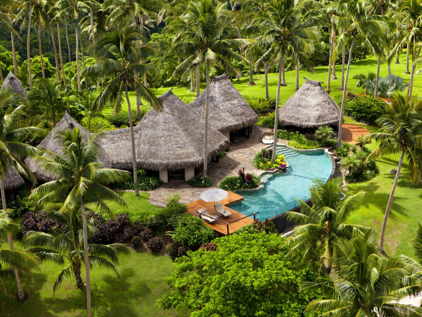 All-Inclusive Resorts Boutique Hotels Hotels Romance tree outdoor archaeological site botany Jungle rainforest Garden Resort tropics Forest Nature botanical garden flower plant agriculture pond area surrounded lush wooded