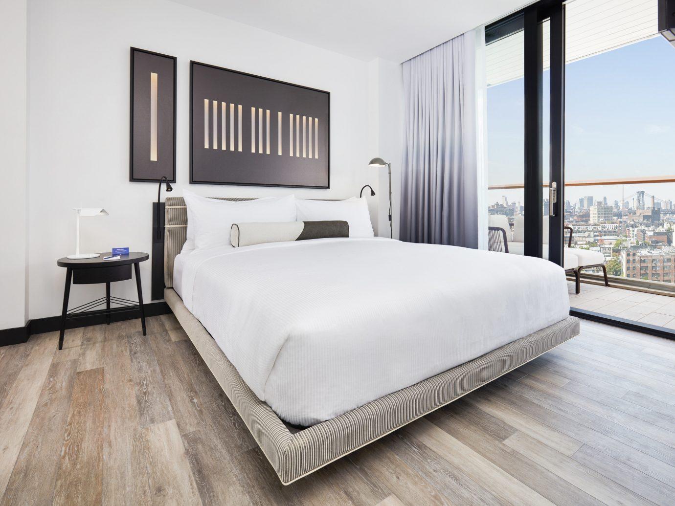 Hotels floor bed indoor wall room Bedroom property window hotel hardwood bed frame furniture real estate interior design estate bed sheet wood flooring flooring laminate flooring Suite