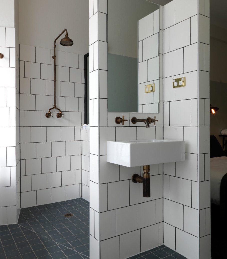 Hotels indoor floor room bathroom plumbing fixture flooring tile white interior design toilet public toilet Design apartment tiled