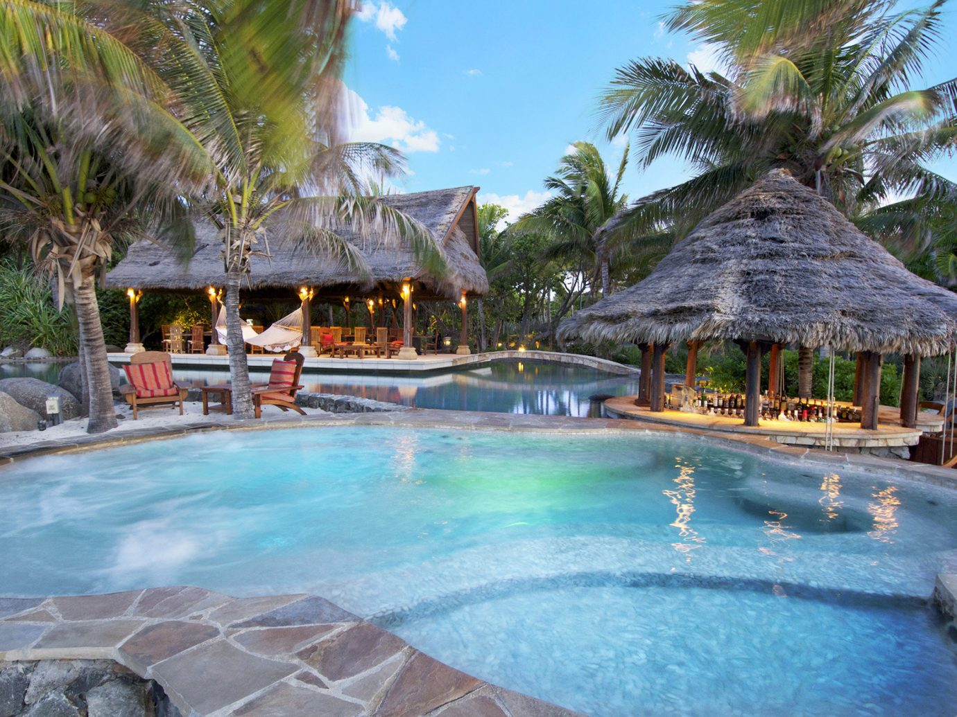 Trip Ideas tree outdoor Resort swimming pool leisure resort town water palm tree arecales vacation real estate estate tropics tourism Pool hacienda Villa caribbean Lagoon hotel stone swimming surrounded