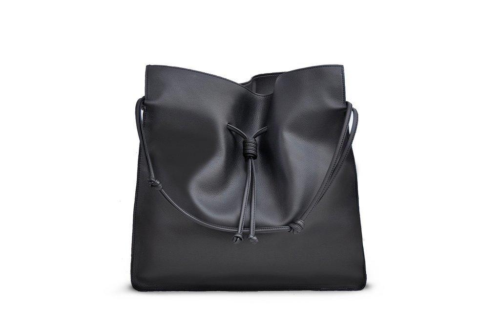 Influencers + Tastemakers Style + Design Travel Shop Trip Ideas black bag indoor handbag product shoulder bag leather accessory product design brand case
