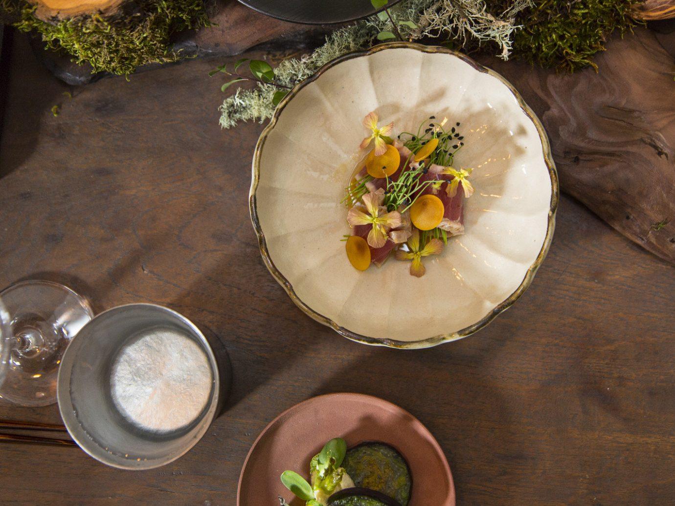 Food + Drink table food wooden dish meal produce leaf flower restaurant meat vegetable